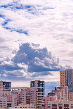 Dark Clouds Over Modern Buildings Stock Photo