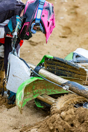 Close-up of accident in mountain bikes race in dirt track with flying debris during an acceleration Stockfoto