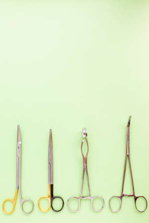 Medical equipments including surgical instruments on green background, top view Stock Photo
