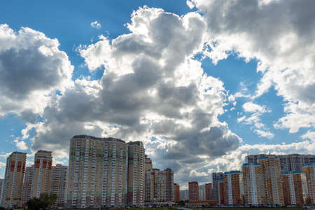 High-rise buildings against the sky on a background of a cloudy sky 스톡 콘텐츠 - 107937209