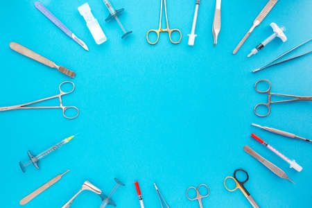 Flat lay of medical instruments on blue background. Mock up health care medical background. Stock Photo