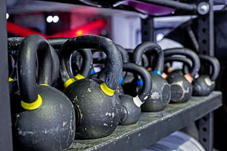 kettlebells for burn fat in the body in the sport gym, Healthy lifestyle and sport concept