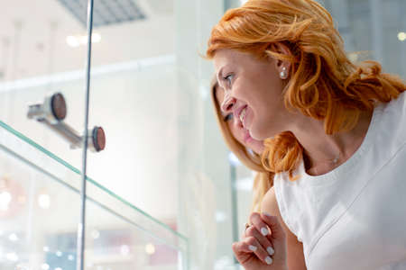 Two Girl Are Looking at Jewelry Shop Display Window Stock Photo
