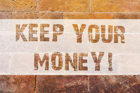 Text sign showing Keep Your Money. Conceptual photo Save incomes for the future Invest financial balance Brick Wall art like Graffiti motivational call written on the wall Stock Photo