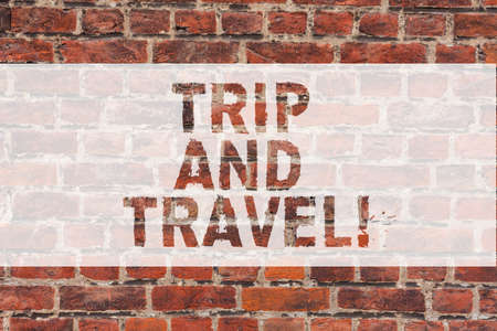 Handwriting text writing Trip And Travel. Concept meaning Journeys for vacation cheerful happy knowing new places Brick Wall art like Graffiti motivational call written on the wall Foto de archivo