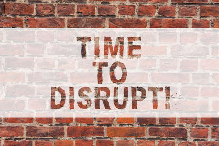 Handwriting text writing Time To Disrupt. Concept meaning Moment of disruption innovation required right now Brick Wall art like Graffiti motivational call written on the wall