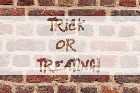 Writing note showing Trick Or Treating. Business photo showcasing take part in the custom of trick or treat halloween party Brick Wall art like Graffiti motivational call written on the wall Archivio Fotografico