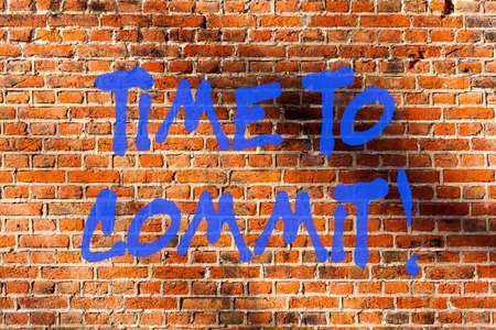 Conceptual hand writing showing Time To Commit. Business photo text Engagement or obligation that restricts freedom of action Brick Wall art like Graffiti motivational call written on the wall