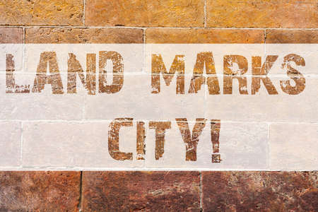 Text sign showing Land Marks City. Conceptual photo Important architecture places in the cities to visit Brick Wall art like Graffiti motivational call written on the wall Banco de Imagens