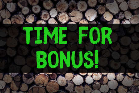 Conceptual hand writing showing Time For Bonus. Business photo showcasing a sum of money added to a demonstrating s is wages as a reward Wooden background vintage wood wild message intentions thoughts Фото со стока