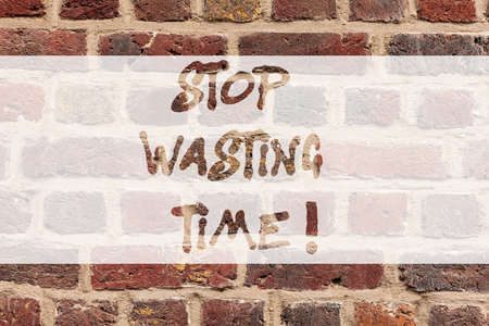 Writing note showing Stop Wasting Time. Business photo showcasing doing something that unnecessary does not produce benefit Brick Wall art like Graffiti motivational call written on the wall