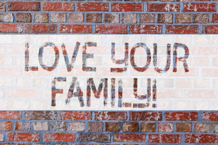 Handwriting text writing Love Your Family. Concept meaning willingness of each member to sacrifice anything for them Brick Wall art like Graffiti motivational call written on the wall