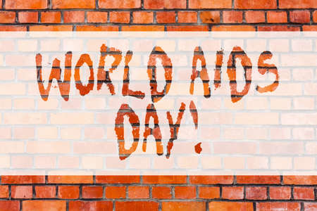Writing note showing World Aids Day. Business photo showcasing 1st December dedicated to raising awareness of the AIDS Brick Wall art like Graffiti motivational call written on the wall Archivio Fotografico