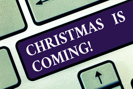 Text sign showing Christmas Is Coming. Conceptual photo annual Christian festival celebrating Christs birth here Keyboard key Intention to create computer message pressing keypad idea
