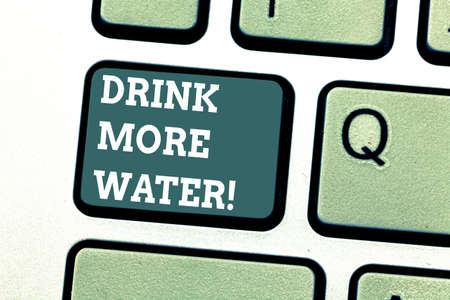 Writing note showing Drink More Water. Business photo showcasing increase amount of drinking water required varies everyday Keyboard key Intention to create computer message pressing keypad idea