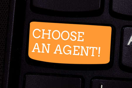 Text sign showing Choose An Agent. Conceptual photo Choose someone who chooses decisions on behalf of you Keyboard key Intention to create computer message pressing keypad idea Фото со стока