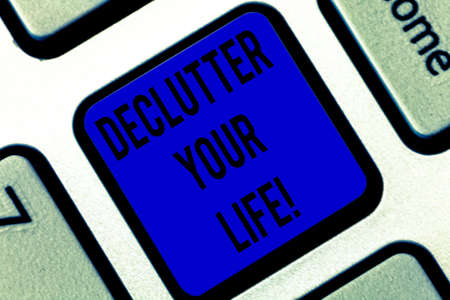 Writing note showing Declutter Your Life. Business photo showcasing remove unnecessary items from untidy overcrowded place Keyboard key Intention to create computer message pressing keypad idea