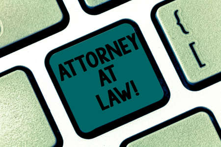 Handwriting text writing Attorney At Law. Concept meaning legal practitioner who deals with most of legal matters Keyboard key Intention to create computer message pressing keypad idea