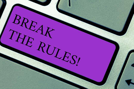 Text sign showing Break The Rules. Conceptual photo Make changes do everything different Rebellion Reform Keyboard key Intention to create computer message pressing keypad idea