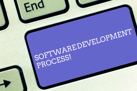 Conceptual hand writing showing Software Development Process. Business photo text Process of developing a software product Keyboard key Intention to create computer message idea
