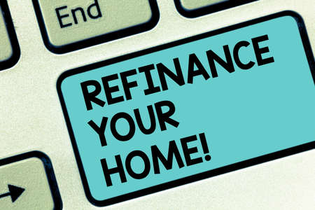 Word writing text Refinance Your Home. Business concept for allow borrower to obtain better interest term and rate Keyboard key Intention to create computer message pressing keypad idea Stock Photo