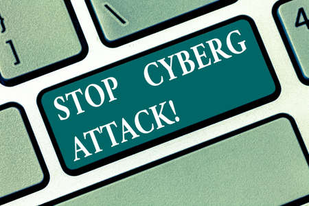 Writing note showing Stop Cyber Attack. Business photo showcasing prevent attempt by hackers damage destroy computer network Keyboard key Intention to create computer message pressing keypad idea