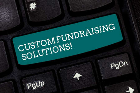 Writing note showing Custom Fundraising Solutions. Business photo showcasing software to help raising money online Keyboard key Intention to create computer message pressing keypad idea Stock Photo