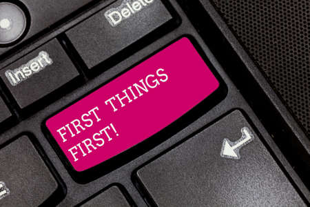Writing note showing First Things First. Business photo showcasing important matters should dealt with before other things Keyboard key Intention to create computer message pressing keypad idea