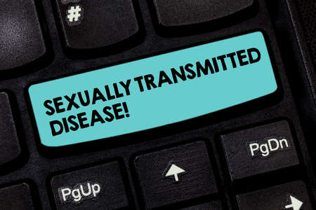Text sign showing Sexually Transmitted Disease. Conceptual photo Diseases spread by sexual intercourse Keyboard key Intention to create computer message pressing keypad idea Imagens