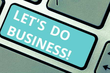 Conceptual hand writing showing Let S Do Business. Business photo showcasing one sells goods or services to others or countries Keyboard key Intention to create computer message idea