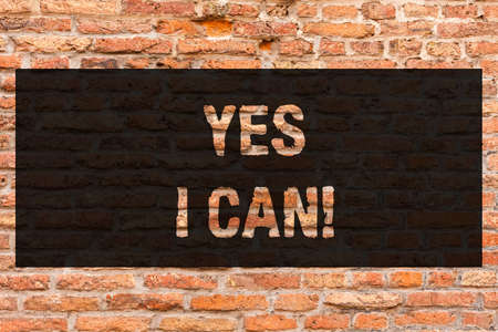 Writing note showing Yes I Can. Business photo showcasing Motivation to do something have the enough strength to keep going Brick Wall art like Graffiti motivational call written on the wall Stock Photo