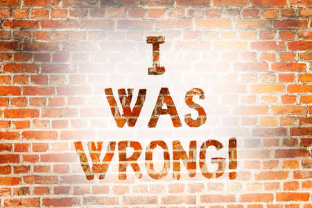 Writing note showing I Was Wrong. Business photo showcasing Acceptance of a mistake error Giving an apology Failure Brick Wall art like Graffiti motivational call written on the wall