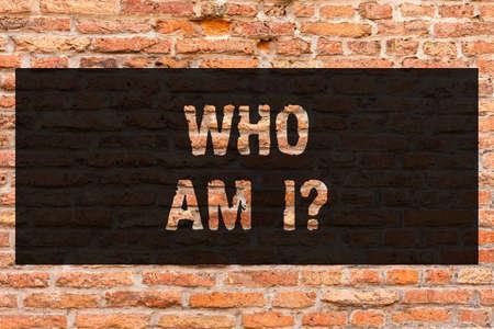 Writing note showing Who Am I. Business photo showcasing Introduce Identify yourself demonstratingality likes dislikes profile Brick Wall art like Graffiti motivational call written on the wall
