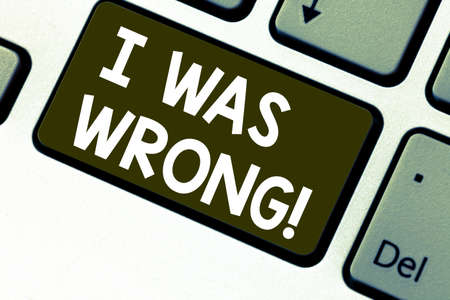 Text sign showing I Was Wrong. Conceptual photo Acceptance of a mistake error Giving an apology Failure Keyboard key Intention to create computer message pressing keypad idea