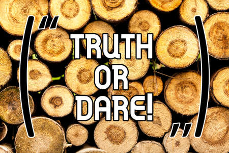 Handwriting text Truth Or Dare. Concept meaning Tell the actual facts or be willing to accept a challenge Wooden background vintage wood wild message ideas intentions thoughts Stock Photo