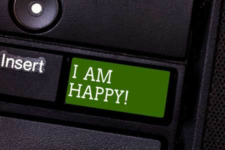 Handwriting text I Am Happy. Concept meaning To have a fulfilled life full of love good job happiness Keyboard key Intention to create computer message pressing keypad idea Фото со стока