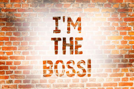 Writing note showing I M The Boss. Business photo showcasing Be the one that gives orders on a job or particular situation Brick Wall art like Graffiti motivational call written on the wall 写真素材