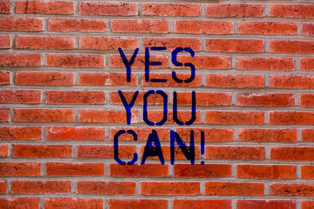 Text sign showing Yes You Can. Conceptual photo Positivity Encouragement Persuade Dare Confidence Uphold Brick Wall art like Graffiti motivational call written on the wall Imagens