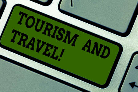 Text sign showing Tourism And Travel. Conceptual photo business attracting accommodating entertaining tourists Keyboard key Intention to create computer message pressing keypad idea Stok Fotoğraf