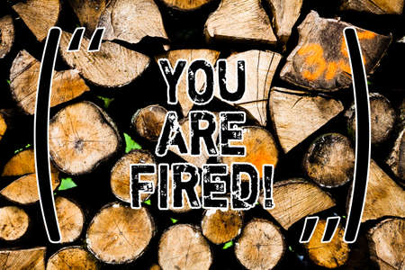 Word writing text You Are Fired. Business concept for Getting out from the job and become jobless not end the career Wooden background vintage wood wild message ideas intentions thoughts