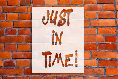 Handwriting text writing Just In Time. Concept meaning Arriving exactly at hour required Punctuality Responsibility Brick Wall art like Graffiti motivational call written on the wall