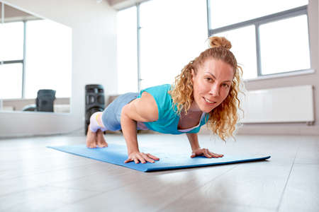 Athletic attractive woman wrung out in gym. Training concept, sport, workout process