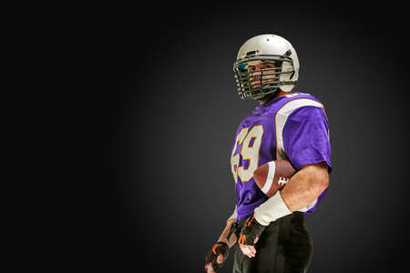 American football player in action with ball Stockfoto