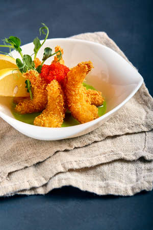 fried shrimps in batter with spinach sauce