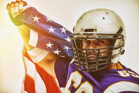 Football Player with uniform and a american flag celebrates victory, on a white background.