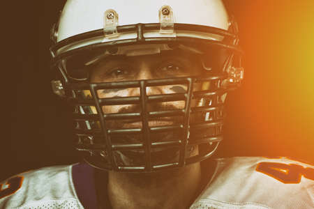 Portrait close-up, American football player, bearded in helmet. Concept American football, patriotism, close-up.