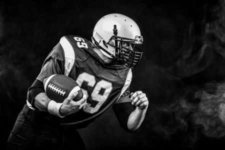Portrait close-up, American football player, bearded without a helmet with the ball in his hands. Concept American football, patriotism, close-up.