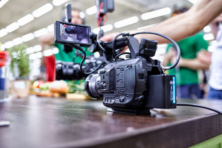 Behind the scenes of video production or video shooting. The concept of production of video content for TV, blog, shows, movies. Cameras prepared for video filming Stock Photo