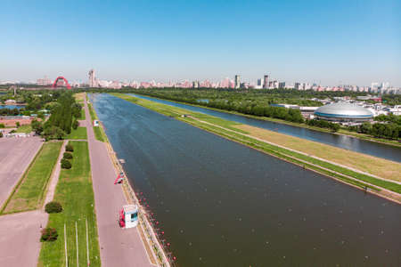 Rowing canal illuminated by bright sunshine. Panoramic view. Shooting from above, aerial filming.  rowing canal in Moscow. Stock Photo