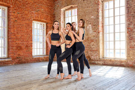 Concept teamwork, movement life, sport, beauty, success. Beautiful fitness girls in a fitness room, having fun before a workout. Stock Photo - 124757212